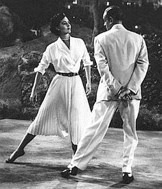 """Cyd Charisse & Fred Astaire in 'Dancing in The Dark' segment of the 1953 film 'The Band Wagon.' Perhaps the most famous dance scenein the film. Set in Central Park.   In his autobiography, Astaire paid tribute to Charisse, calling her """"beautiful dynamite"""" and writing: """"That Cyd! When you've danced with her you stay danced with."""""""
