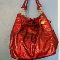 "Big Buddha Union Bucket Bag This gorgeous red bucket bag features gold hardware and a lovely croc patterned PVC exterior. Lots of space! Has 3 interior pockets one w/zipper. Very good condition only has a few peeling spots but not very noticeable. Originally $65 14"" X 9"" X 14 Big Buddha Bags Shoulder Bags"