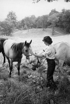 I love this photo of Jackie because it shows the more casual side of being around horses, as if she has gone into the field to catch them for her children to ride, as we often do here on the farm.