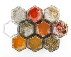 A colorful magnetic spice rack that turns your fridge into a gorgeous honeycomb: