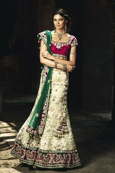 Net bridal ghagra, with contrast velvet blouse embellished with anchor thread and zardosi work with contrast net dupatta.