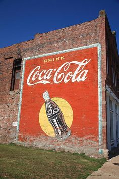 Route 66 Fine Art Photography. A Coca-Cola mural on one of the turn of the century buildings in Stroud, Oklahoma, on old Rt. 66.