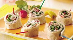 Pretty spirals filled with thin-sliced turkey from the deli, fresh greens, peppers, and creamy dressing, roll up fast for a quick lunch or appetizer.