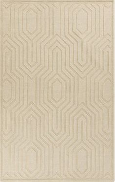 Solid ivory rug from Surya has a high/low pile geometric design giving it an interesting and unique factor (M-5314).