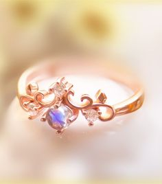rose gold art deco blue moonstone promise ring for her http://www.jewelsin.com/p-rose-gold-plated-925-silver-moonstone-princess-crown-ring-1481