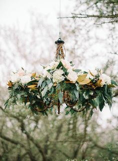 Romantic Neutral Wedding Ideas - rustic wrought iron chandelier dressed with flowers and foliage