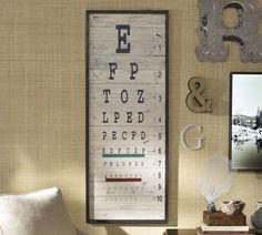 "Pottery Barn  This stylized eye chart's oversized letters are painted on distressed wood, giving a vintage feel to this unique piece of art.        * 19"" wide x 51"" high x 1.5"" deep      * Made of planked fir frame with a distressed hand-painted finish."