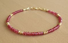 Hey, I found this really awesome Etsy listing at https://www.etsy.com/listing/173058812/garnet-bracelet-with-gold-beads-gemstone