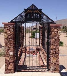 "Concordia Cemetery, El Paso, TX ....John Wesley Hardin's grave.  It is gated to protect the tombstone from ""collectors.""  Live by the gun; die by the gun."