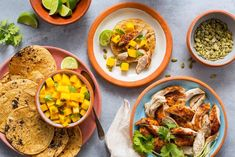 Smoky shredded-chicken tacos with mango salsa