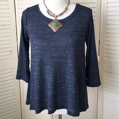 One Clothing muted blue waffle top Soft and comfy! Lovely muted marled blue poly/rayon/cotton blend knit. Moderate amount of stretch. High scoop neck in front, low V neck in back. Three-quarter length sleeves. Hi-low hem. Marked size M; in my opinion, will fit a L, as well. (Dress form is a size 12/14, for reference.) NWT; never worn. one clothing Tops Tees - Long Sleeve