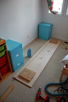 DIY Filing Cabinet Desk - Last year we built an 8 foot long filing cabinet desk for our kids bedroom, using second hand filing cabinets that we painted.