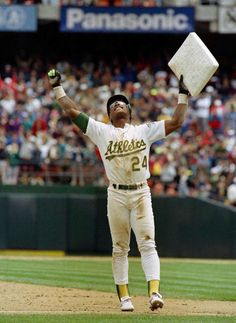 In this May 1, 1991, file photo, Oakland Athletics' Rickey Henderson celebrates and raises third base after setting the all-time stolen base record during the Athletics' baseball game in Oakland, Calif., against the New York Yankees. The stolen base was Henderson's 939th, moving him past Lou Brock. Henderson was voted into baseball's Hall of Fame on Monday, Jan. 12, 2009.