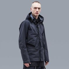 J56 is an Acronym rendition of the classic 4 pocket field jacket. Unique zipless waterproof windproof front closure is a fully contemporaneous nod to tradition. All new detached entry cargo chest pockets exemplify Acronym garment engineering. The J56 feature set will illustrate the difference between what we do and what everyone else does over the years it's in your employ.