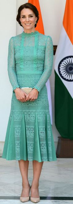 For a meeting with India's Prime Minister Narendra Modi in New Delhi, Kate Middleton wore a jade lace Temperley London dress accessorized with nude pointed heels and a corresponding clutch.