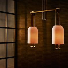 Rusty reds dominate Apparatus' installation, in which the New York studio is presenting new furniture and lighting in a seemingly East Asian-inspired setting. Tables have translucent resin blocks for bases and lacquered tops that match the booth's colour scheme. A ribbed bell-shaped light shade made from slip-cast porcelain is repeated in a variety of lighting configurations, each with metal fixtures that coordinate with other new lamps in the brand's range.