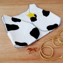 Using a simple pattern and felt, you can whip up a spotted vest just like Woody's!