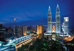 Kaula Lumpur, Malaysia.  The city I will use as my hub thanks to Air Asia... Also, one of my favorite cities in the world.  I could (and may) live here one day.