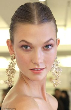 Karlie Kloss backstage at Oscar de la Renta S/S 2014 in New York City
