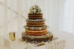 Why not have 3 different flavours of cake - one per tier? This lovely naked cake looked and tasted delicious. Photo by Benjamin Stuart Photography #weddingphotography #weddingcake #flavourcake #nakedcake #weddingday #weddingideas