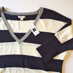 "GAP striped V neck sweater Light V neck sweater. Navy and light cream large stripe with gray neckline trim.  Banded hem.  Fits TTS.  24"" from shoulder to hem.  Slight dolman style sleeves.   No trades. Reasonable offers welcome Note: 20% off bundles of 2+ items in my closet! GAP Sweaters V-Necks"