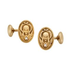 Egyptian Revival Diamond Gold Cufflinks. A pair of Art Nouveau 14K yellow gold oval cufflinks in the Egyptian Revival style. Circa 1900. Stamped 14K.