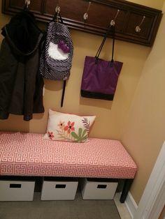 Hallway closet redo. No doors. Cute bench and storage baskets.