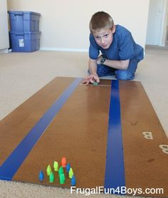 We have every item needed for a little living room bowling. DIY marble bowling!  Fun for a rainy day.