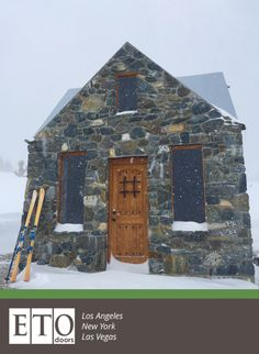 This snowy cottage is complete with a rustic wooden door from ETO.