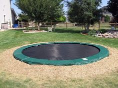 in-ground trampoline with squishy stuff around it...no falling off and breaking of things :D