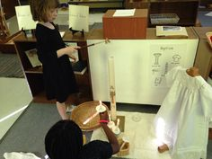 Children working with Baptism works