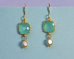 Square framed aqua faceted gem with a tiny cube glass pearl.