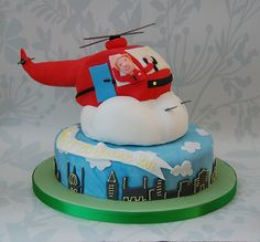 Helicopter cake flying over the city.