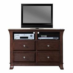 Constructed of hardwood solids with a light cherry finish Brown felt lines top drawer Satin nickel finished hardware