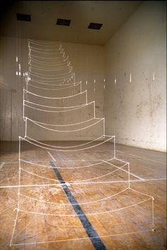 Maggie Casey: Staircase; string, monofilament, staples 2004 & 2006. Staircase was first installed in an abandoned racquetball court, then later recreated in a gallery context