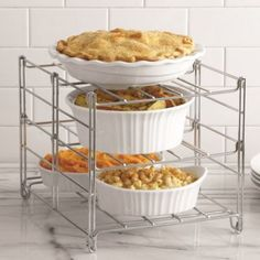 "Real Simple® 3-Tier Adjustable Oven Rack -  Maximize your oven and countertop space with this 3-tier adjustable oven rack. Collapsible for easy storage, this rack fits most ovens and is a must-have for any kitchen in need of some extra space. Measures 13.5"" L x 11"" W x 10.5"" H Dishwasher and oven safe BedBathandBeyond.com"