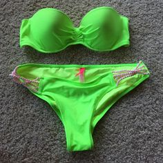 Victoria's Secret Swim Victoria's Secret swim suit set. Brand new without tags, never worn! Top is a 36B bottom is a medium. Neon green color, with braided straps on the back of the top and on the hips of the bottoms. Victoria's Secret Swim Bikinis