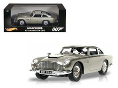 "Hot wheels Aston Martin DB5 Silver James Bond 007 From ""Goldfinger"" Movie 1/18 Diecast Model Car by Hotwheels - Brand new 1:18 scale diecast car model of Aston Martin DB5 Silver James Bond 007 From ""Goldfinger"" Movie die cast car model by Hotwheels. Brand new box. Rubber tires. Has steerable wheels. Has opening doors. Made of diecast metal. Detailed interior, exterior. Dimensions approximately L-10.5, W-4.5, H-3.5 inches.-Weight: 4. Height: 8. Width: 15. Box Weight: 4. Box Width: 15. Box…"