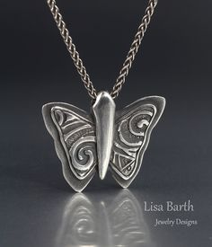 Here is the back of the pendant, with a different look so you get a two in one piece.  :)  Lisa Barth