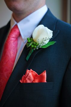 Coral and turquoise wedding with cream Vendela rose and Hypericum berry boutonniere.  Photography by www.marikokayphotography.com