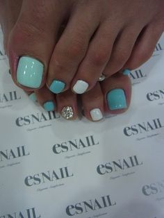Summer toenails LOVE that blue green color.. I'm getting my toes done like this tomorrow :)