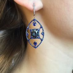 An atypical yet harmonic combination of blue spinels and sapphires.                       #spinel#sapphire#earrings#handcrafted#gold#ivy#ivynewyork