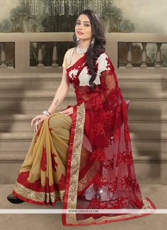 Aspiring to make a mark in the world of style! Here is the attire to breath life into your aspirations. Steal the hearts away with this red georgette and net designer saree. The embroidered and patch ...