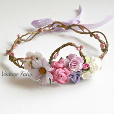 The princess flower crown is one of my best sellers, it is made using soft purple, pink and white flowers. The bark wire is twisted and pink berries are twisted around it.I have clustered the flowers at the front and placed a sweet pink bird in amongst
