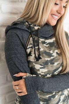 "A weathered brown Camo with Charcoal Accents. All hooded sweatshirt styles feature: zipper detail, double hood with play in front, hidden thumbholes, and hidden pockets! Basically the best hoodies on planet earth. Fabric: 95% Cotton 5% Elastane All sizes are 21"" in length from underarm. This material has medium stretch. SIZE SLEEVE BUST WAIST HIP XS 26.5 36"" 31"" 34"" S 27"" 38"" 33"" 36"" M 27 1/2"" 38.5"" 33"" 36"" L 28"" 41"" 36"" 40"" XL 29"" 42.5"" 37"" 40"" 2XL 29"" 45"" 39"" 42"" 3XL 29"" 46"" 40"" 44"""