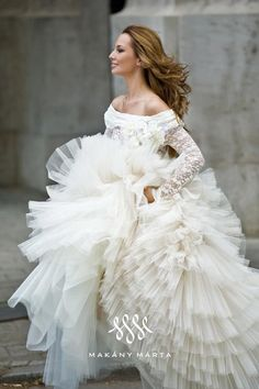 Just gorgeous. Don't think you could fit one more tulle ruffle on that dress! via AbsolutelyLadylike.com