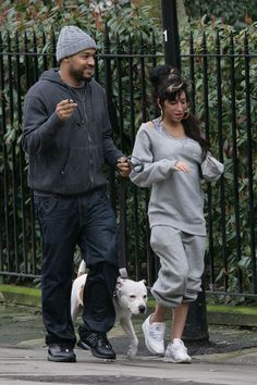 Amy walking with music producer Salaam Remi.