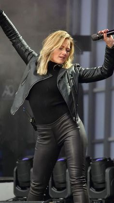 Blonde in leather jacket and pants