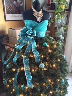 How creative! A dress form with Christmas tree as the skirt! designed by Shari G. of Bakersfield, CA and raffled off at an event where the proceeds went to a charity Mannequin Christmas Tree, Dress Form Christmas Tree, Christmas Tree Garland, Blue Christmas, Holiday Tree, Xmas Tree, Beautiful Christmas, Christmas Holidays, Peacock Christmas Tree