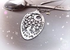 Handcrafted and recycled Victorian silver spoon moon gazing hares necklace made in Cambridge by Hairy Growler